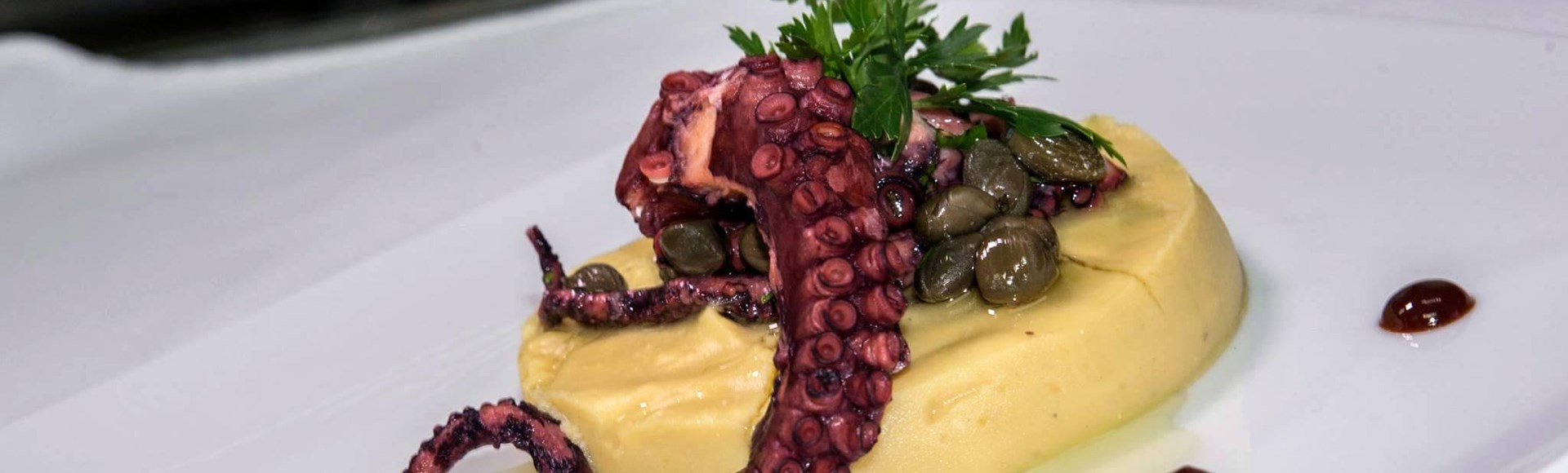 grilled-octopus-on-fava-bed-traditional-broad-peas-spread-served-with-caper-and-drops-of-balsamic-vinegar - Private Chef Service For Your Villa Holidays In Santorini, Cyclades, Greece