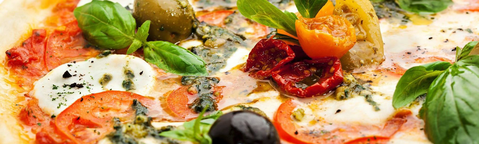 mediterranean-pizza-with-olives-basil-mozzarella-and-cherry-tomatoes - Private Chef Service For Your Villa Holidays In Santorini, Cyclades, Greece