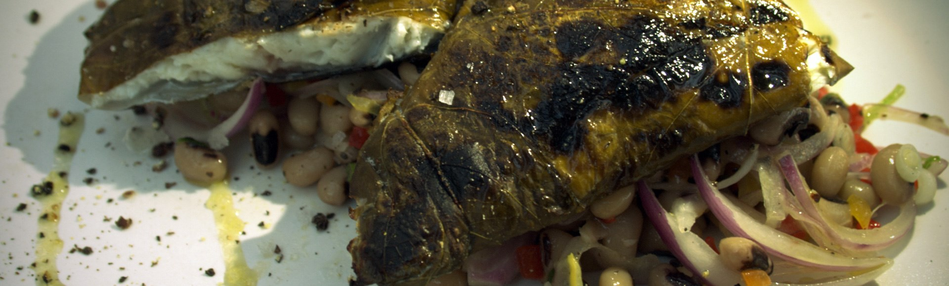 grilled-seabass-fillet-wrapped-in-vine-leaves-private-chef-chania-1 - Private Chef Service For Your Villa Holidays In Crete